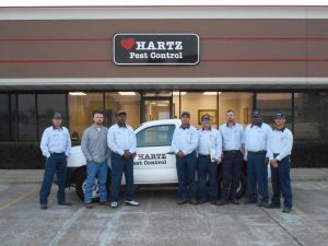 Hartz Pest Control Sugarland Exterminators pose for picture