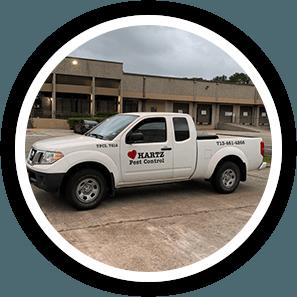 Hartz Pest Control Houston Exterminator service truck.